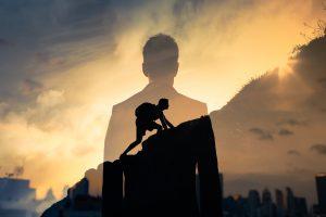 a man climbing the mountain